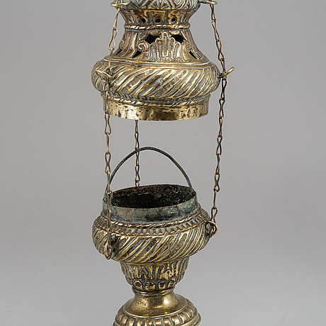 An 18th century brass incense burner.