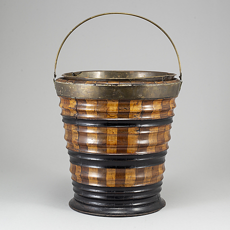 A 19th century brass and wood wine cooler.
