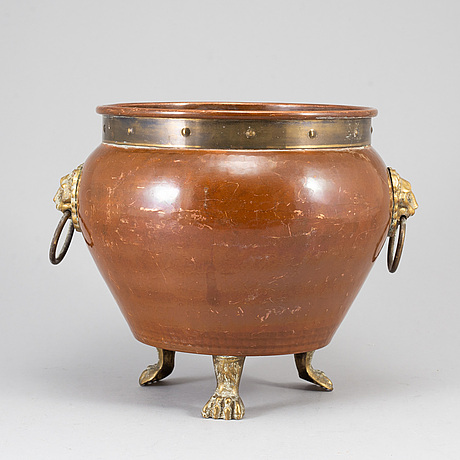 A 19th century brass and copper champagne cooler.