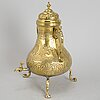 A brass tea urn, 19th century.