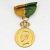 An 18k gold medal.
