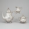 A silver coffee pot, creamer and sugar bowl, swedish import mark by johan schurmann, landskrona 1923.