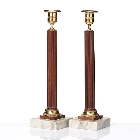 A pair of late gustavian late 18th century candlesticks.