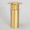 A brass candle stick by tapio wirkkala, kultakeskus oy, finland.