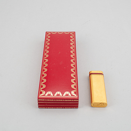 A cartier lighter and pen.