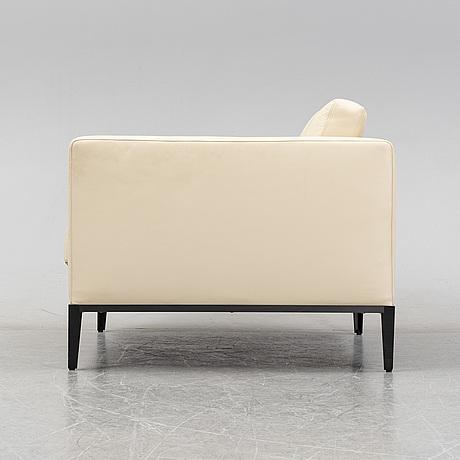An 'ac lounge chair' by antonio citterio, b&b italia.