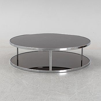 Rodolgo Dordoni, a 'Huber glass and chrome coffe table for Minotti.