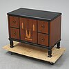 An early 20th century art deco chest of drawers.