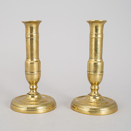 A 19th century pair of brass candlesticks.