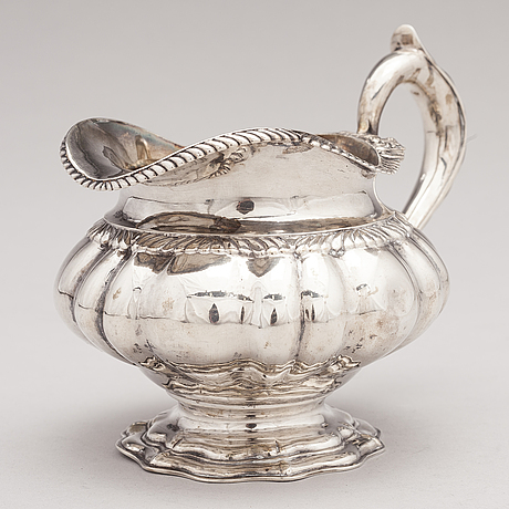 A silver milk jug, marked schleissner, hanau, germany latter half of the 19th century.