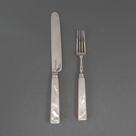 An english set of 24 silver and mother-of-pearl fruit cutlery, mark of joseph willmore, birmingham 1822/23.
