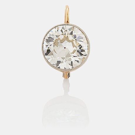 An earring in 14k gold and platinum set with an old-cut diamond ca 2.50 cts qulity ca i/j si.