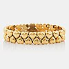 "A cartier 18k gold ""double hearts"" bracelet."