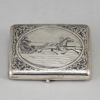 A Russian parcel-gilt silver and niello cigarette-case, import marks 1882-98.