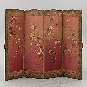 A Japanese embroidered four fold screen, 20th Century.