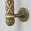 Alvar aalto, a bronze door handle, for taito oy, finland.