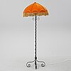 A iron floor lamp from the first half of the 20th century.