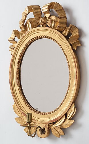 A pair of gustavian late 18th century one-light girandole mirrors.