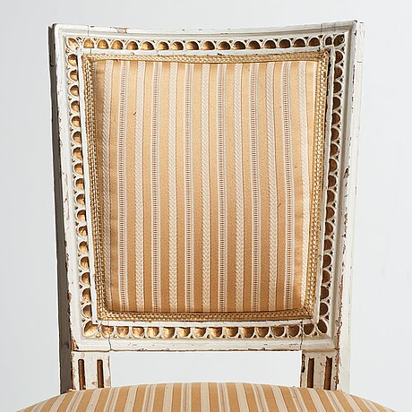 A set of four gustavian chairs.