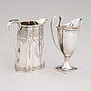 Two sterling silver milk jugs, mark of thomas hyde 1783 and walter & john barnard 1877, london.