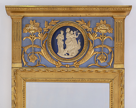 An early 20th century gustavian style mirror with a console table.