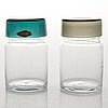 Saara hopea, a set of five 1950s glass jars with covers by nuutajärvi, finland.