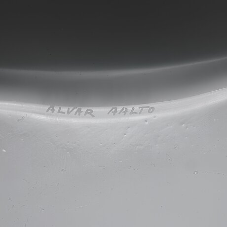Alvar aalto, a white mould blown glass vase, iittala, finland, model 3031.