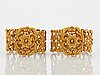 A pair of 19th century 18k gold bracelets.