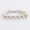 """Tiffany & co bracelet and earrings sterling silver """"ballbracelet and earrings"""" original pouch and box."""