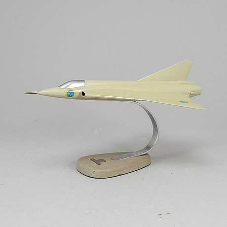 A second half of the 20th century aluminum scale model of an saab j-35 airplane.