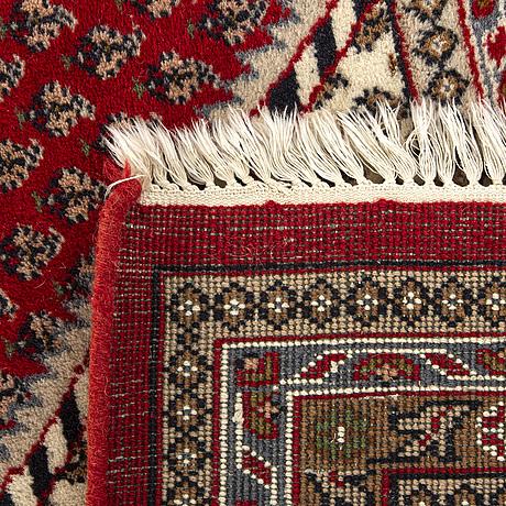 An old oriental carpet ca 340 x 249 cm.