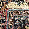 A semiantique signed kirman carpet ca 389 x 275 cm.