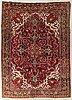 An old heriz carpet ca 348 x 246 cm.