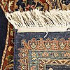 An oriental carpet ca 120 x 99 cm.