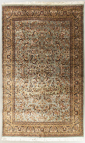 An old oriental carpet ca 354 x 242 cm.