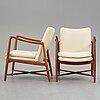 """Finn juhl, a pair of """"bo59"""" teak easy chairs, bovirke denmark, 1950-60's."""
