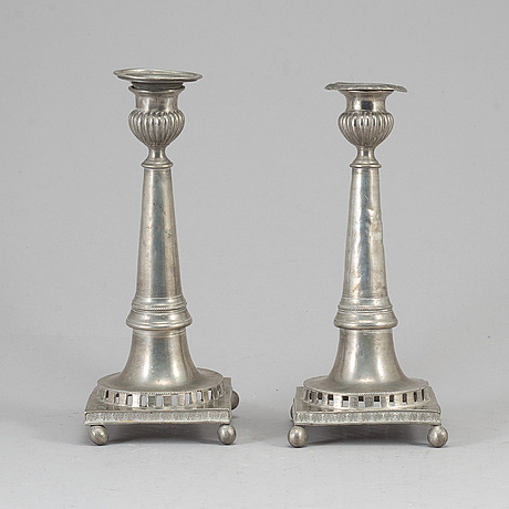 A pair of swedish pewter candlesticks dated 1858.