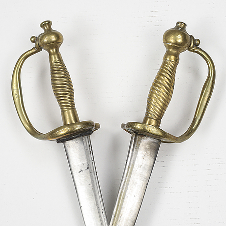 Two swedish cutlasses 1748-1856 pattern with scabbards.