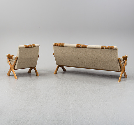 A 1960/70's pine sofa, armchair and coffee table.