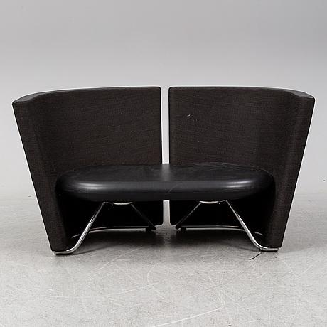 A 'rotor' sofa by foersom & hjort for erik jorgensen.