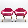 A pair of du 55 p armchairs by gastone rinaldi,  model designed in 1954.