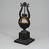KlockstÄll, gjutjärn, troligen berlin, ca 1820-30-tal.