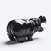 A carved obisidian hippo figurne.