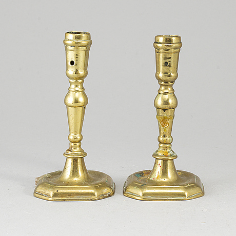 A pair of 18th century bronze candlesticks.