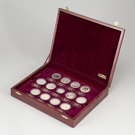 A collection of 13 silver coins.