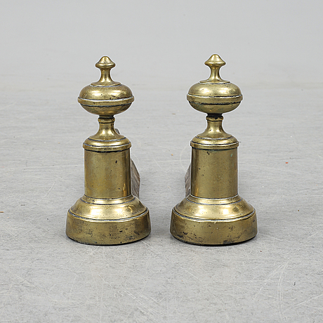 A pair of brass and iron fire dogs, les frères morel à charleville, france, late 19th century.