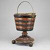 A 19th century wooden champagne cooler.