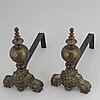 A pair of louis xvi-style brass andirons.