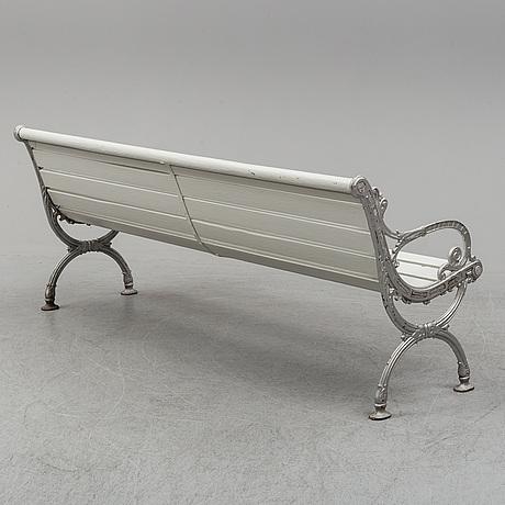 A husqvarna cast iron garden sofa.