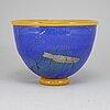 A glass bowl by j e ritzman, sweden, transjö, 20th century.